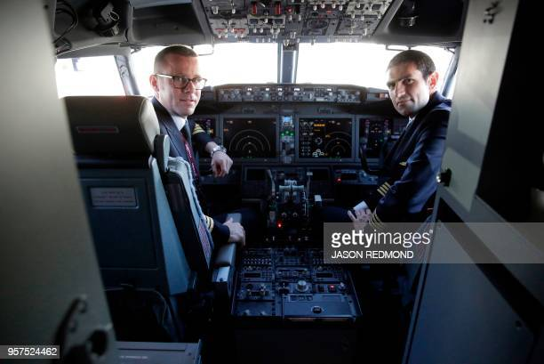 Pilots are pose inside the cockpit of a Boeing 737 MAX 8 as Boeing Commercial Airplanes Qatar Airways and Air Italy celebrate the delivery of their...