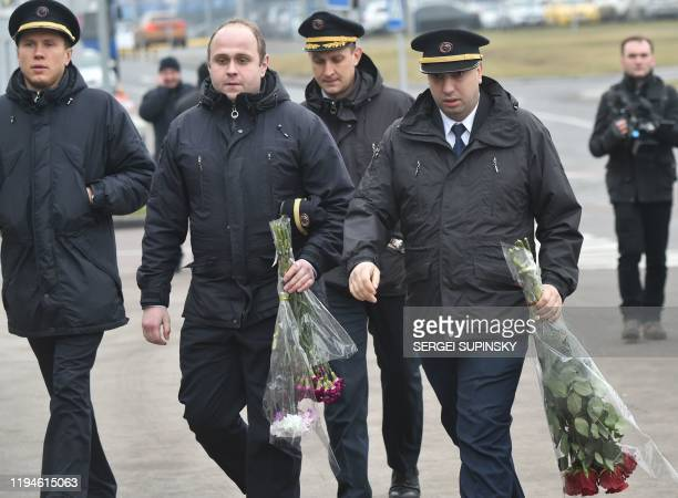 Pilots arrive to attend a tribute ceremony of the 11 Ukrainians who died in a plane mistakenly shot down by Iran during a spike in tensions with...