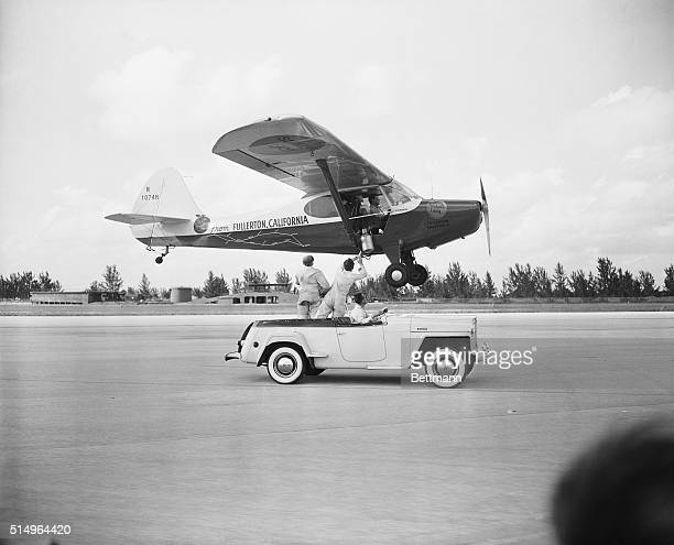 Pilots Bill Barris and Dick Riedel receive some inflight assistance from a speeding car as they try to break the flying endurance record While...