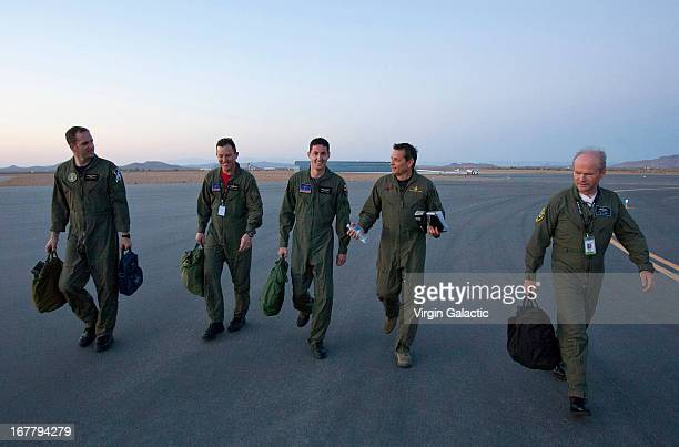 Pilots, Clint Nichols,Mike Alsbury,Brian Maisler, Mark Stuckey and Dave McKay of Virgin Galactic's WhiteKnight2 and SpaceShip2 walk towards the...