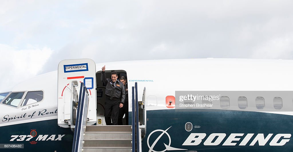 Pilots Craig Bomben, left, and Ed Wilson emerge from from a Boeing 737 MAX 8 airliner at Boeing Field after completing the plane's first flight on January 29, 2016 in Seattle, Washington. The 737 MAX is the newest generation of Boeing's most popular airliner featuring more fuel efficient engines and redesigned wings.