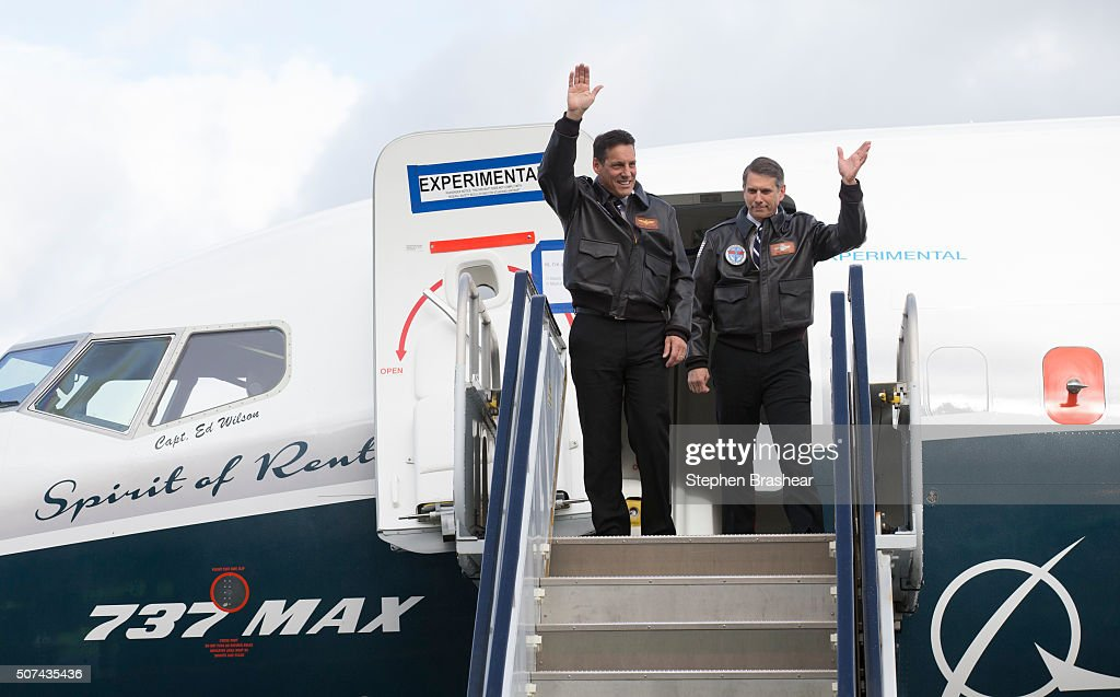 Pilots Craig Bomben, left, and Ed Wilson wave to a crowd while deplaning from a Boeing 737 MAX 8 airliner at Boeing Field after completing the plane's first flight on January 29, 2016 in Seattle, Washington. The 737 MAX is the newest generation of Boeing's most popular airliner featuring more fuel efficient engines and redesigned wings.