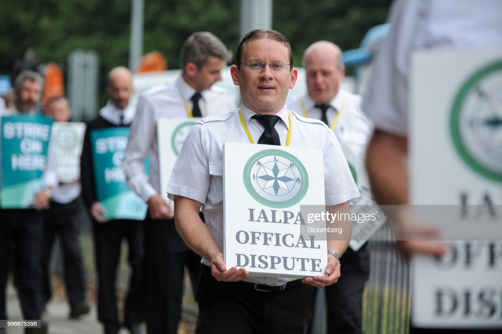 Pilots for Ryanair Holdings Plc and members of Irish Air Line Pilots' Association in Ireland's Forsa union carry signs as they march during a strike near the entrance to Dublin Airport in Dublin, Ireland, on Thursday, July 12, 2018. Ryanair grounded dozens of flights Thursday as pilots in its Irish home market walked out after failing to agree new contracts as part of a move toward unionization at the discount giant. Photographer: Aidan Crawley/Bloomberg via Getty Images