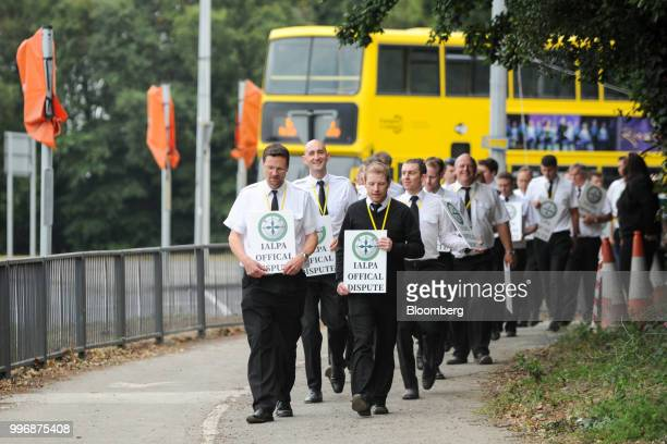 Pilots for Ryanair Holdings Plc and members of Irish Air Line Pilots' Association in Ireland's Forsa union carry signs as they march during a strike...