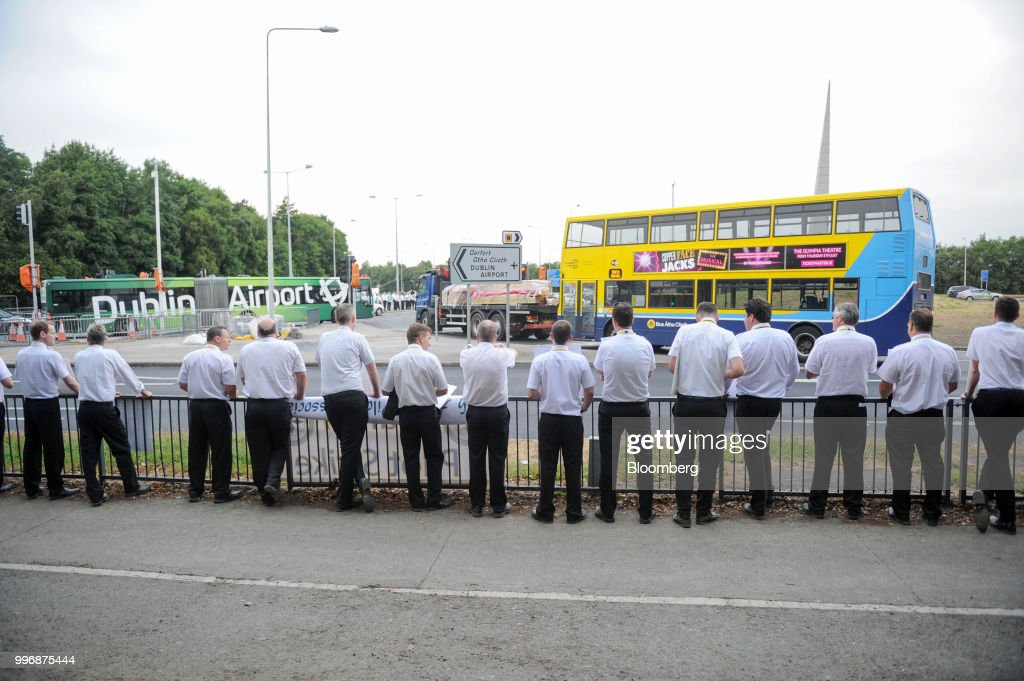 Pilots for Ryanair Holdings Plc and members of Irish Air Line Pilots' Association in Ireland's Forsa union stand on a picket line as they take part in a strike near the entrance to Dublin Airport in Dublin, Ireland, on Thursday, July 12, 2018. Ryanair grounded dozens of flights Thursday as pilots in its Irish home market walked out after failing to agree new contracts as part of a move toward unionization at the discount giant. Photographer: Aidan Crawley/Bloomberg via Getty Images