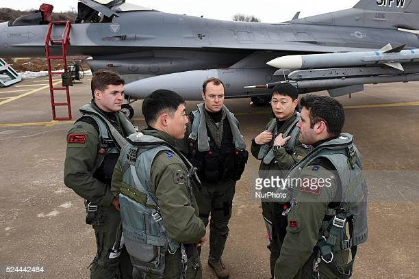 Pilots from the 36th Fighter Squadron US Air Force and the 121st Fighter Squadron Republic of Korea air force communicate before takeoff during Buddy...