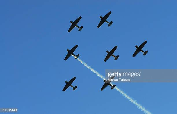 Pilots from The Condor Squad fly six vintage World War II warbirds in the 'missing man' formation in tribute to fallen veterans in a flyby over the...