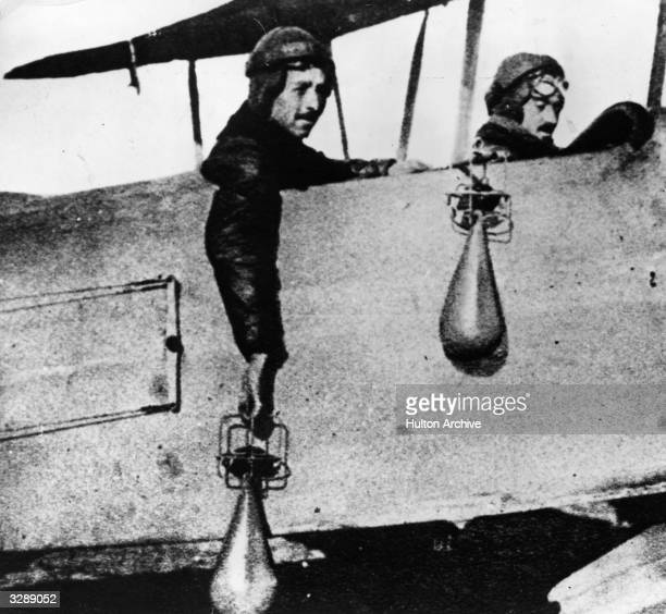 Pilots from the Royal Air Force ready to drop bombs by hand over Germany from their aeroplane a development as in the first stages of the war planes...