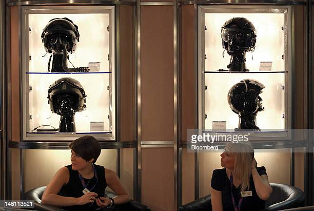 ALPHA pilot's helmets sit on display on the second day of the Farnborough International Air Show in Farnborough UK on Tuesday July 10 2012 The...