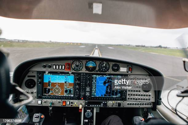 pilots in cockpit of small twin engine private aircraft - aeroplane stock pictures, royalty-free photos & images