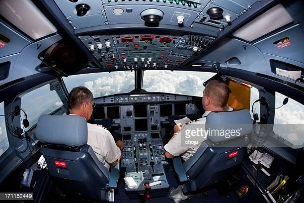 pilots in the cockpit during a commercial flight - piloting stock pictures, royalty-free photos & images