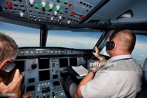 pilots in the cockpit during a commercial flight - team captain stock pictures, royalty-free photos & images