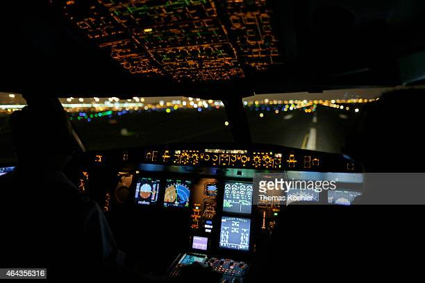 Pilots in the cockpit of an Airbus A340 of the German Special Air Mission Wing while the aircraft is approaching Lima airport on February 14 2015 in...