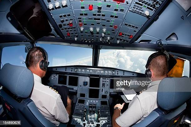Pilots in the cockpit of commercial airplane