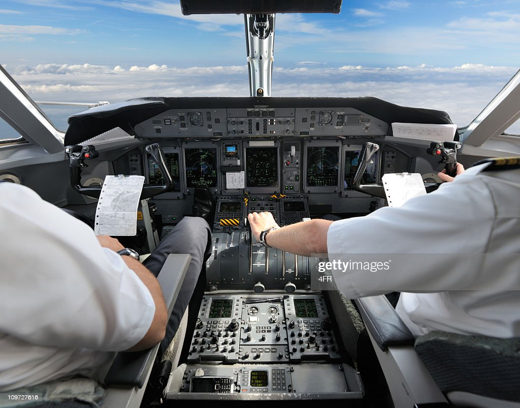 Pilots in the Cockpit - Preparing for Landing : Stock Photo