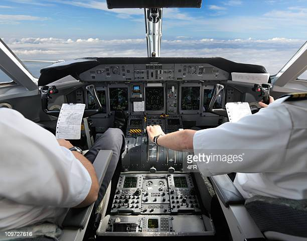 pilots in the cockpit - preparing for landing - piloting stock pictures, royalty-free photos & images