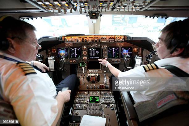 Pilots make final checks before flying a consignment of aid from Oxfam's logistics warehouse in Oxfordshire on a British Airways flight bound for...