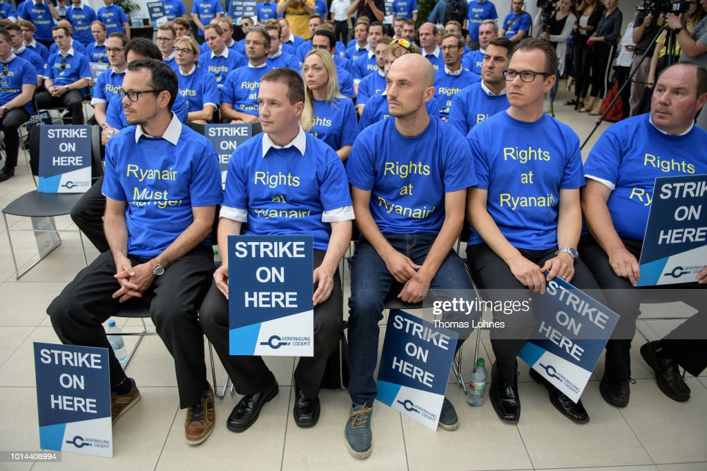 Pilots of discount airliner RyanAir gather at the headquarters of the pilots' labor union Vereinigung Cockpit during a 24-hour strike by the pilots on August 10, 2018 in Frankfurt, Germany. RyanAir pilots in Germany, Ireland, Sweden, Belgium and Holland are taking part in the strike over demands for better pay and working conditions.