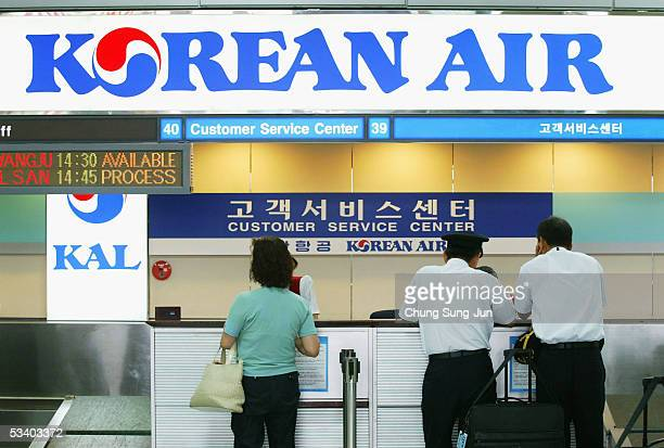 Pilots of Korean Airline are seen at the Korean Airlines ticket and checkin desk at Gimpo Airport on August 18 2005 in Seoul South Korea South...