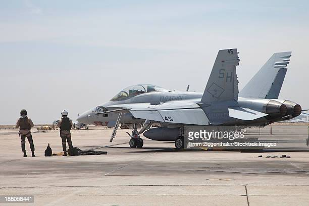 Pilots of Marine Fighter Attack Training Squadron 101 (VMFAT-101), waiting to board their F/A-18B Hornet at Marine Corps Air Station Miramar, California.