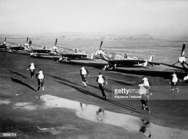 Pilots of the Free French Spitfire Squadron running to their planes