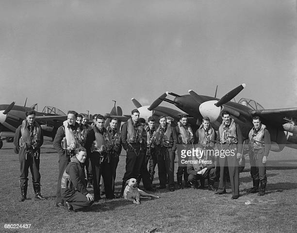 Pilots of the Westland Whirlwind singleseat twinengined cannonarmed fighter bomber of No137 Squadron of the Royal Air Force gather around their...