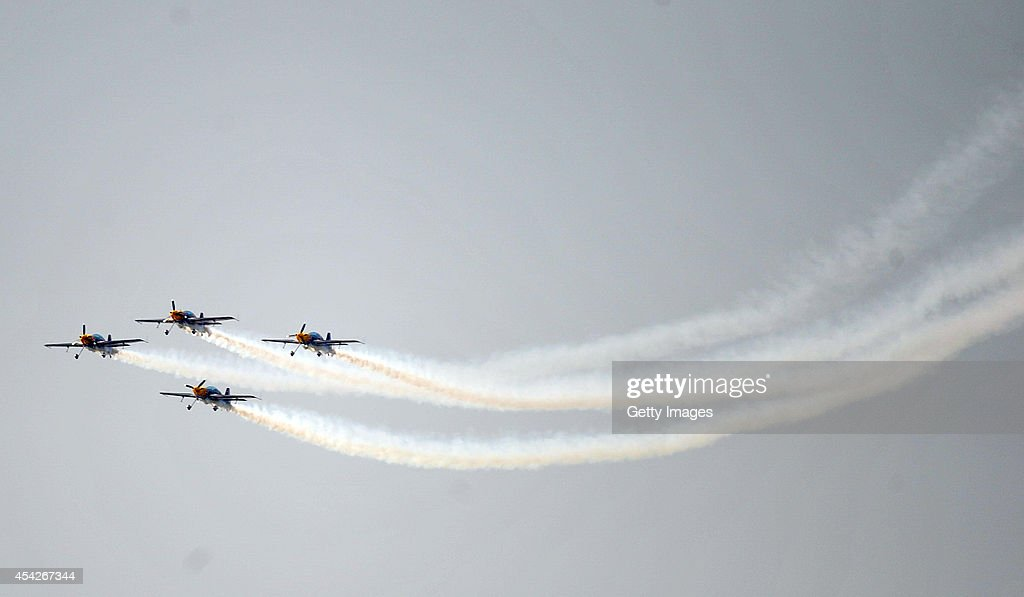Pilots perform aerobatic flight during a contest on August 27, 2014 in Shenyang, Liaoning province of China. Three aerobatic flight teams participated in an international aerobatic flight contest held in Shenyang from August 27 to August 31.