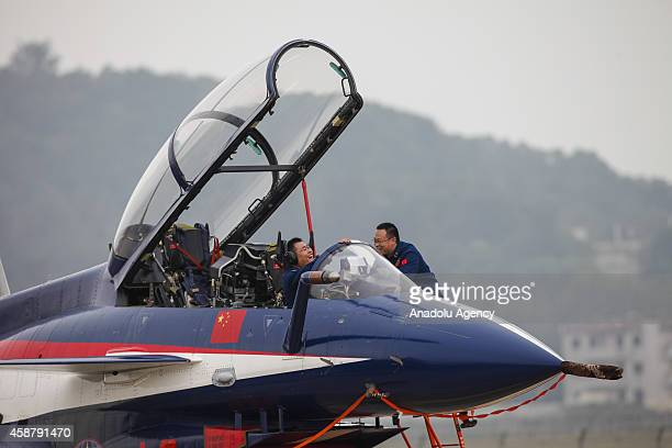 Pilots prepare Chinese J10 airplane for flight at the Airshow China 2014 in Zhuhai Guangdong province November 10 2014 Airshow China is the only...