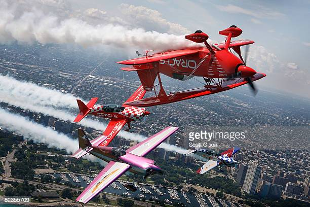 Pilots Sean Tucker his son Eric Bill Stein and Ben Freelove fly their aircraft over Lake Michigan as they prepare for this weekend's Chicago Air and...