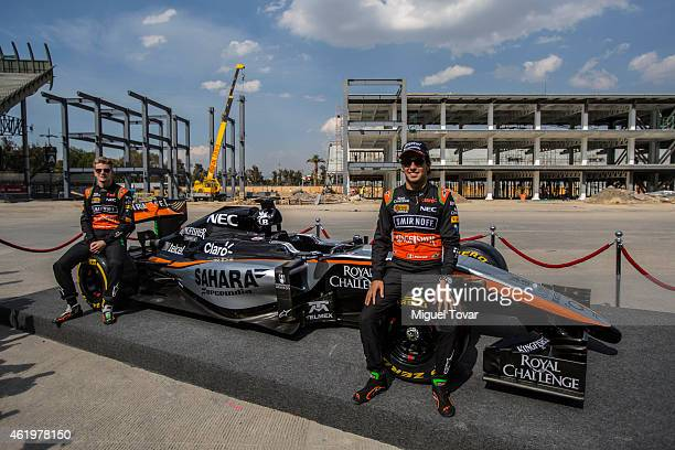 Pilots Sergio Perez and teammate Niko Hulkenberg pose for pictures during a walk through the Hermanos Rodriguez Racing Circuit Facilities on January...