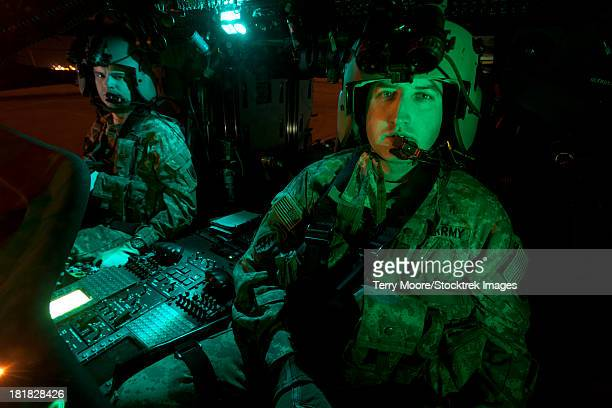 Pilots sitting in the cockpit of a UH-60 Black Hawk helicopter at Davis Monthan Air Force Base, Arizona.