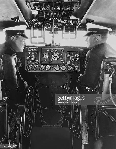 Pilots Sitting In The Cockpit Using Automatic Pilot At San Francisco In California