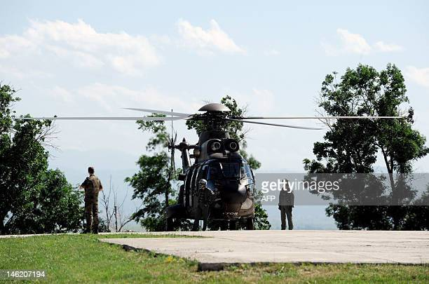 KFOR pilots stand in front of a helicopter during the visit of NATO Military Committee at the KFOR headquarters in Pristina on June 12 2012 AFP...