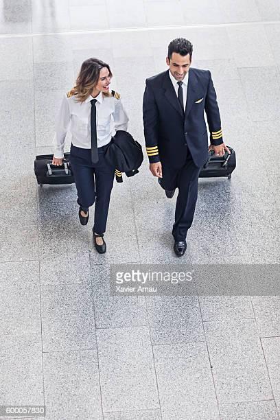 Pilots walking in the airport terminal.