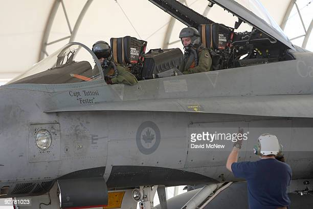 Pilots with the Canadian 410 'Couger' Squadron return to base after a training flight in CF18 Hornet fighter jets at Naval Air Facility El Centro on...