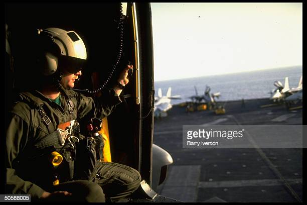 Pilottype peering through prob copter door on bd aircraft carrier USS Independence during gulf crisis US forces buildup Gulf of Oman