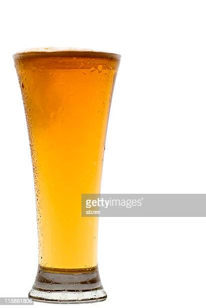 pilsner beer glass to one side of frame - pilsner stock photos and pictures
