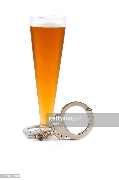 pilsner glass with lager beer handcuffs attached at base - pilsner stock photos and pictures