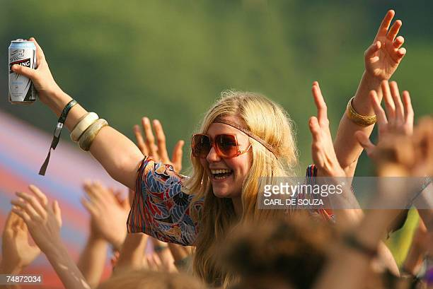 A fan watches British band Babyshambles perform on the Pyramid stage at Glastonbury music festival Pilton Somerset 23 June 2007 177500 people are...