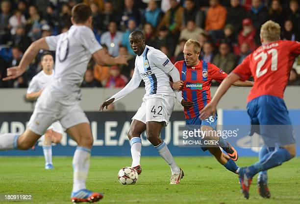 Pilzen´s midfielder Daniel Kolar and Manchester City's Ivorian midfielder Yaya Toure vie for the ball during the UEFA Champions League Group D...