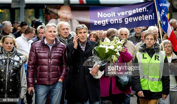 Pim Fortuyn's brother Simon Fortuyn and Pim Fortuyn's former chauffeur Hans Smolders and protestors carrying a photo of late farright Dutch...