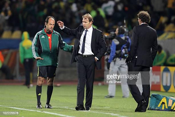 Pim Verbeek head coach of Australia gestures to his players as fourth official Carlos Simon tries to calm him down during the 2010 FIFA World Cup...