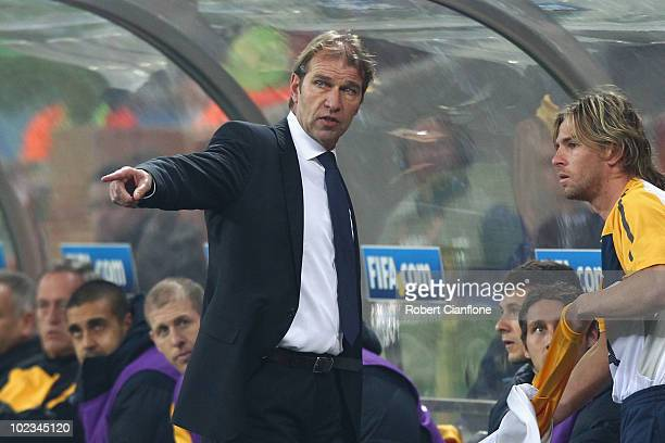 Pim Verbeek head coach of Australia gives instructions to substitute Brett Holman during the 2010 FIFA World Cup South Africa Group D match between...