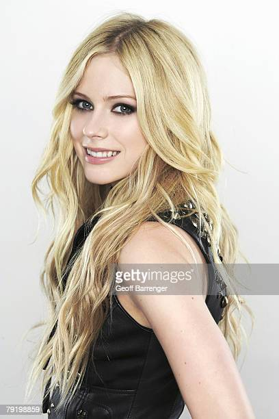 Singer Avril Lavigne poses at a portrait session for Elle Canada Quebec on May 1 2006 in Los Angeles Stylist Jessica Paster Makeup Christian...