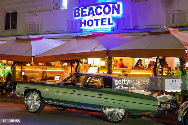 Pimped classic car outside Beacon hotel at night