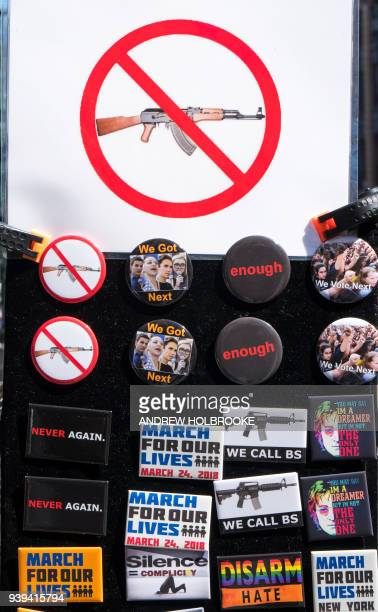 Pin are for sale during the March For Our Lives on March 24 2018 in New York City Thousands of people across the country marched in support of...