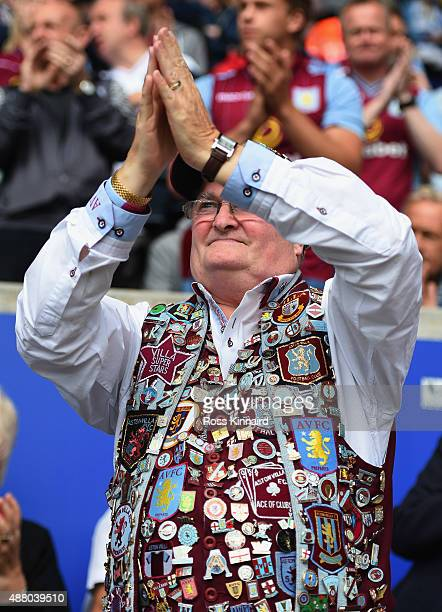 A pin badge clad Aston Villa fan show his support prior to the Barclays Premier League match between Leicester City and Aston Villa at the King Power...