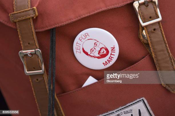 A pin badge reading 'Time For Martin' sits on a supporter's rucksack during an election campaign rally with Social Democrat Party candidate for...