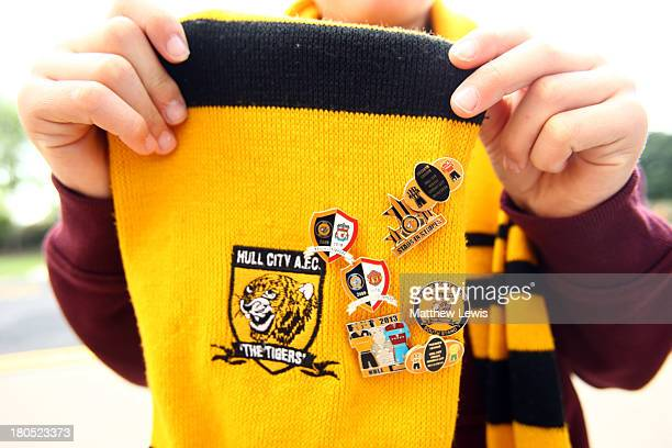 Pin badges are displayed on a Hull City scarf prior to the Barclays Premier League match between Hull City and Cardiff City at KC Stadium on...