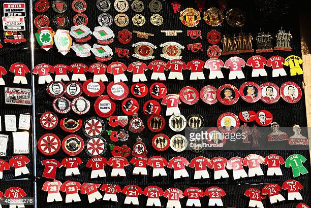 Pin badges for sale prior to the Barclays Premier League match between Manchester United and Tottenham Hotspur at Old Trafford on August 8 2015 in...